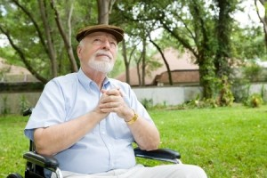 senior-man-in-wheelchair-praying-in-a-beautiful-outdoor-setting